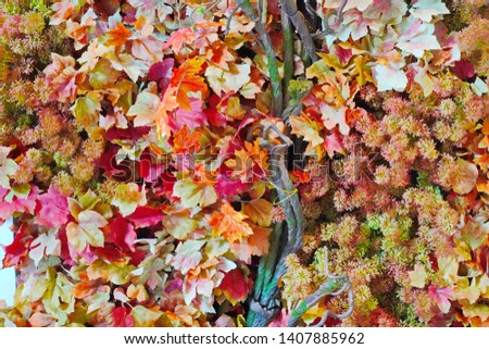 Fake colorful fall foliage leaves texture and background  #1407885962