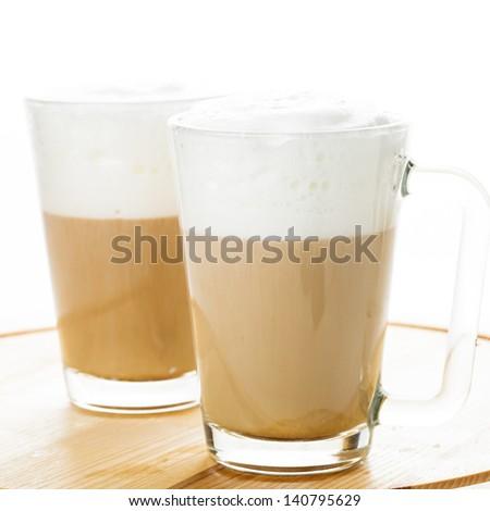 Coffee latte in glass mugs on the board #140795629