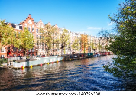 Amsterdam. Wonderful view of city canals and buildings in spring season. #140796388