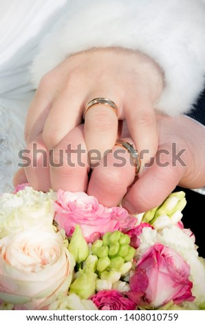 rings on newlyweds hands and bouquet #1408010759