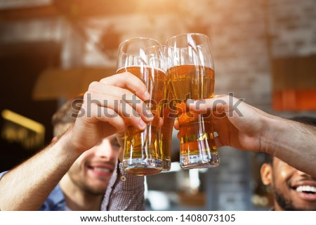 Cheers For Us. Men Drinking Draft Beer And Clinking Glasses At Pub, Closeup #1408073105