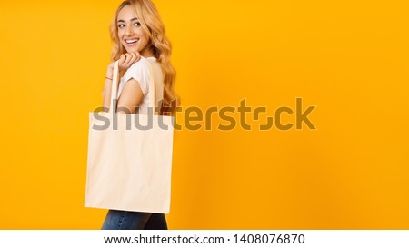 Ecology Concept. Woman With Blank Eco Bag On Yellow Studio Background, Free Space #1408076870