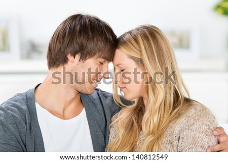 couple with closed eyes, leaning head to head #140812549