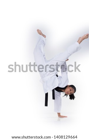 Master Black Belt TaeKwonDo instructor Teacher show traditional Fighting Act pose and warm up in White former dress, studio lighting white background isolated, copy space, motion blur on foots hands #1408129664