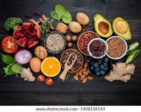 Ingredients for the healthy foods selection. The concept of healthy food set up on wooden background. #1408136543