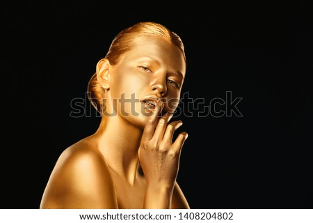 Portrait of beautiful lady with gold paint on skin against black background. Space for text #1408204802