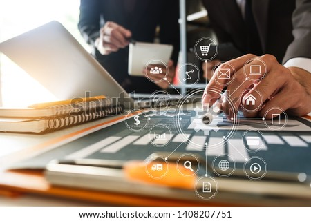Business team present. professional investor working new start up project. tablet laptop computer with digital marketing media  in virtual icon design Finance managers meeting. #1408207751