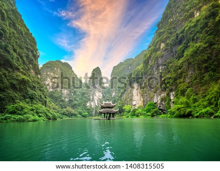 Landscape of Vu Cung at Tam Coc National Park. It was the place where the Tran Dynasty's struggle against the Nguyen Mong army took place and was also the practice place for feudal kings in Vietnam.  #1408315505