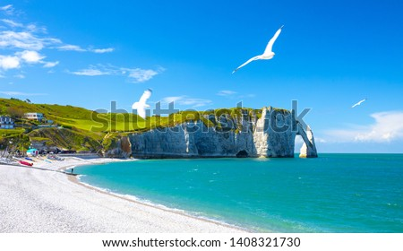 Picturesque panoramic landscape on the cliffs of Etretat. Natural amazing cliffs. Etretat, Normandy, France, La Manche or English Channel. Coast of the Pays de Caux area in sunny summer day. France #1408321730