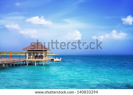 Landscape photo of Island in ocean, overwater villa with endless swimming pools. Maldives. #140833294