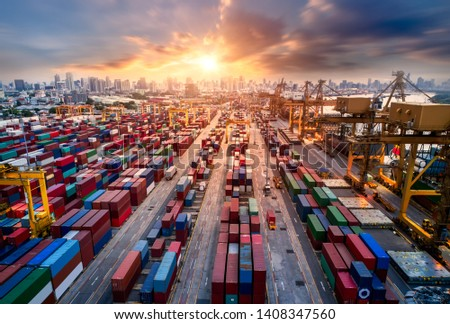 Logistics and transportation of Container Cargo ship and Cargo plane with working crane bridge in shipyard at sunrise, logistic import export and transport industry background #1408347560