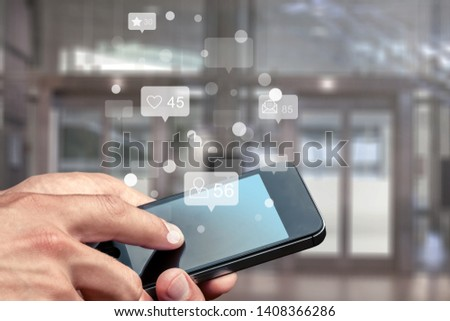Hand with Smart Phone on office background and social illustration #1408366286