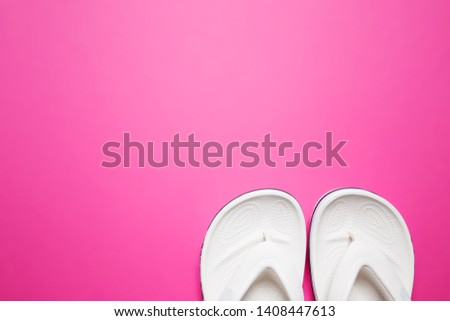 Flip flops on a pink isolated background. White female flip flops. #1408447613