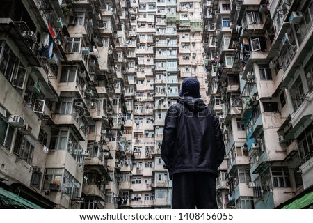 Traveler exploring the urban landscape of Hong Kong, China, one of the most densely populated cities in the world. Royalty-Free Stock Photo #1408456055