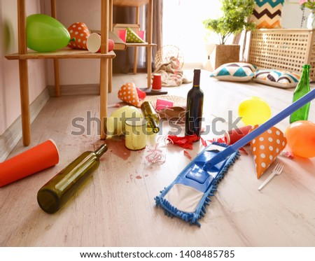 Cleaning of room in terrible mess after party #1408485785