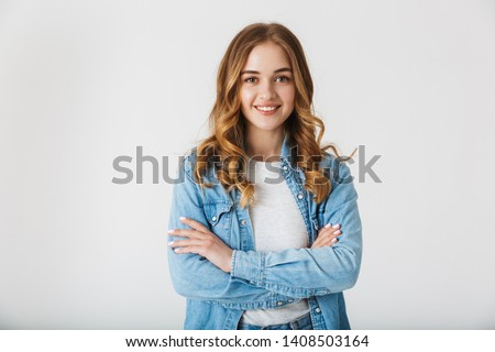 Attractive young girl wearing casual clothes standing isolated over white background, arms folded