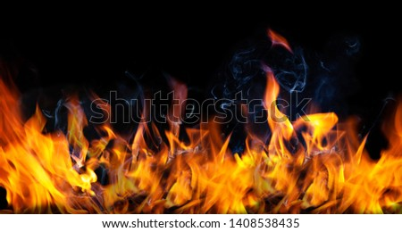Fire flames and Smoke on black color background . Image of burning fire for decorative special effect .  #1408538435