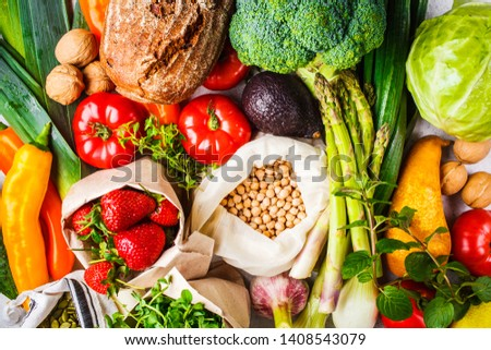 Balanced vegetarian food background. Vegetables, fruits, nuts, sprouts, seeds, chickpeas on a white background, top view. #1408543079