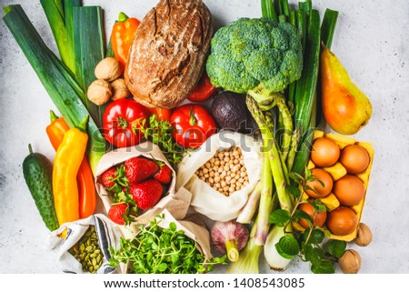 Balanced vegetarian food background. Vegetables, fruits, nuts, sprouts, seeds, chickpeas on a white background, top view. #1408543085