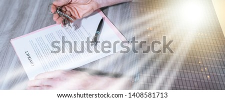 Signature of a real estate contract (lorem ipsum text used); multiple exposure #1408581713
