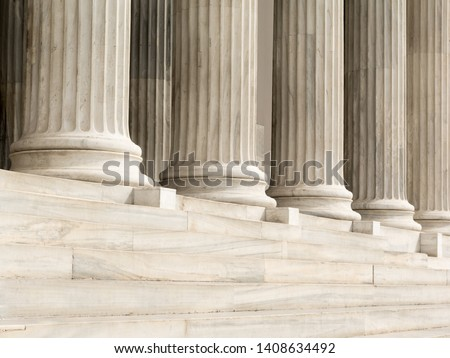 Architectural detail of marble steps and ionic order columns Royalty-Free Stock Photo #1408634492