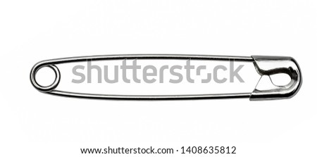 safety pin isolated on white background  Royalty-Free Stock Photo #1408635812