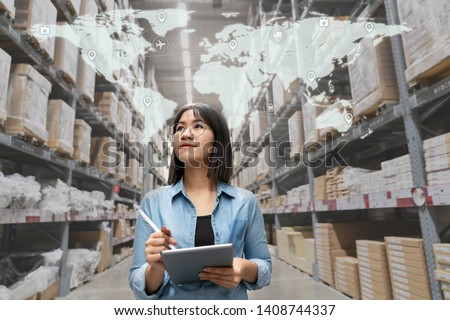 Young attractive asian manager woman looking, picking, replemishment, receiving inventory at store warehouse in warehouse management system concept. Smart ERP with iot for inventory management. #1408744337