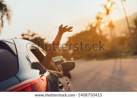 Hatchback Car travel driving road trip of woman summer vacation in blue car at sunset,Girls happy traveling enjoy holidays and relaxation with friends together get the atmosphere and go to destination #1408750415