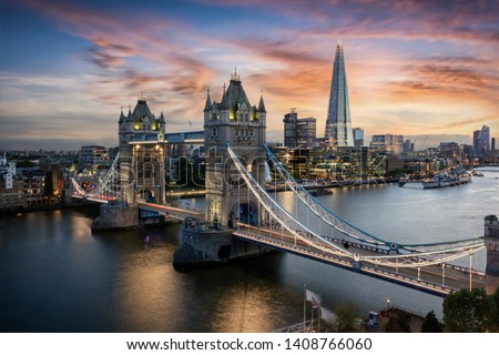 Aerial view to the illuminated Tower Bridge and skyline of London, UK, just after sunset #1408766060