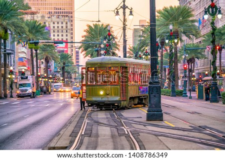 Streetcar in downtown New Orleans, USA at twilight Royalty-Free Stock Photo #1408786349