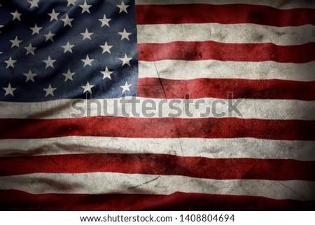 Closeup of grunge American flag Royalty-Free Stock Photo #1408804694