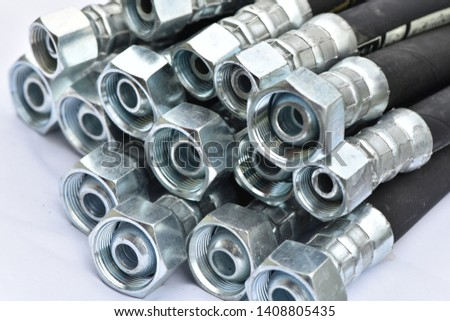 Hydraulic industrial hoses on a white background. Royalty-Free Stock Photo #1408805435
