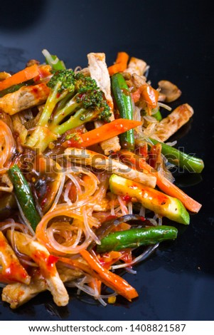 Asian vegetables and beef chicken meat noodles. Restaurant menu #1408821587