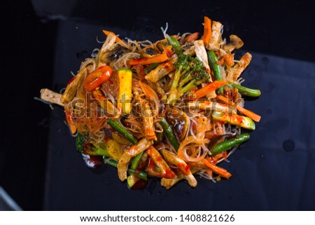 Asian vegetables and beef chicken meat noodles. Restaurant menu #1408821626