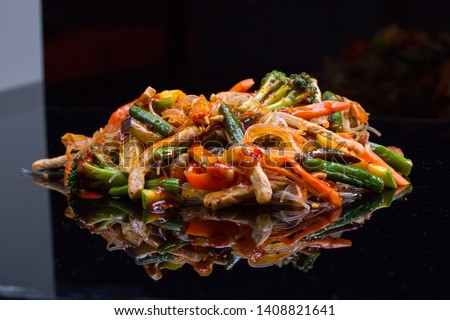 Asian vegetables and beef chicken meat noodles. Restaurant menu #1408821641