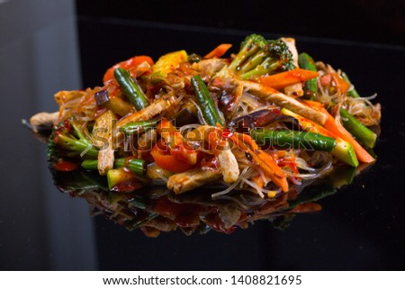 Asian vegetables and beef chicken meat noodles. Restaurant menu #1408821695