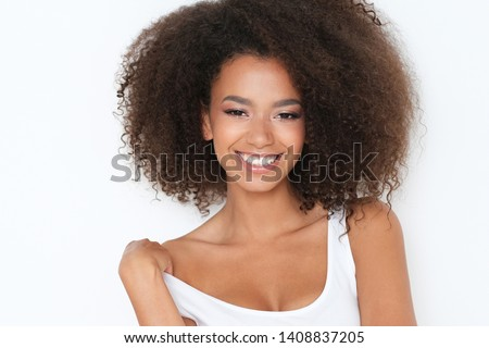 Beautiful nice girl with toothy smile, standing in front of camera. #1408837205