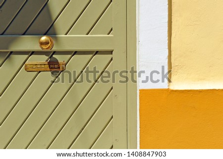 Geometric composition of architecture, forms and colors on the house facade, cartas means letters #1408847903