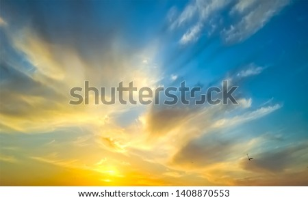 Epic dramatic sunset . Beautiful orange, yellow and blue colors sunset sky for background. #1408870553