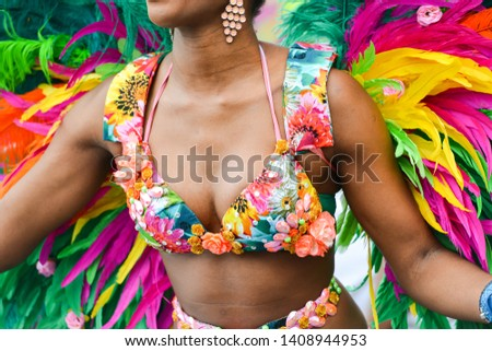 Concept of Caribbean  carnival parade with feathers, colorful background. #1408944953
