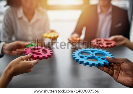 Business team connect pieces of gears. Teamwork, partnership and integration concept #1409007566