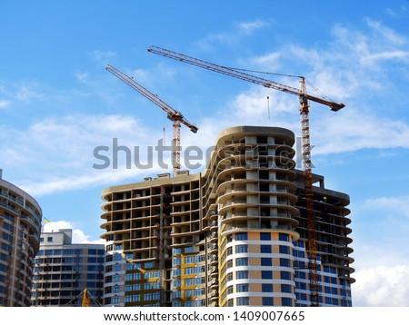 Construction site. High-rise multi-storey buildings under construction. Tower cranes near buildings. #1409007665