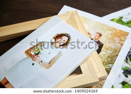 Photo canvas prints. Sample of stretched photography of woman with gallery wrap. Printed photos of a dog and a wedding couple lying on a table