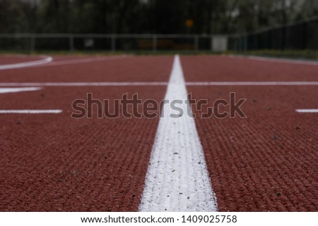 Close up of outdoor track and field course #1409025758