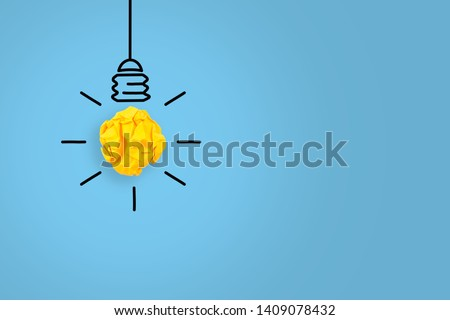 New Idea Concepts Light Bulb with Crumpled Paper on Blue Background