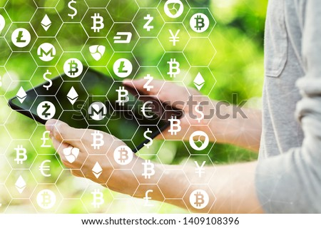 Cryptocurrency with young man holding his tablet computer outside #1409108396