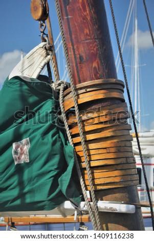 Close Up of Old Wooden Sailboat Mast and Mast Rings #1409116238