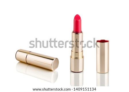 Red lipstick in golden tube on white background with mirror reflection on glass surface isolated close up, shiny gold lipstick package, open and closed lipsticks box, luxury cosmetic accessory set #1409151134