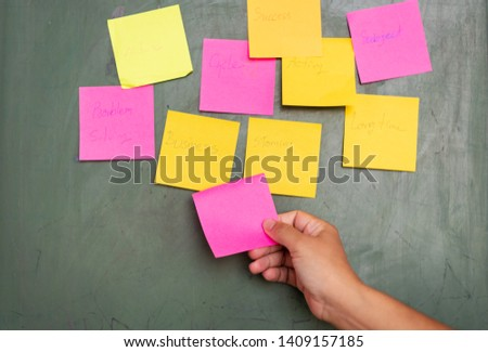 Close up woman hand holding note sticky for brainstorm and share idea strategy workshop business.Brainstorming concept. #1409157185