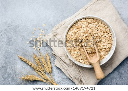 Oat flakes, oats or rolled oats in bowl. Table top view #1409194721